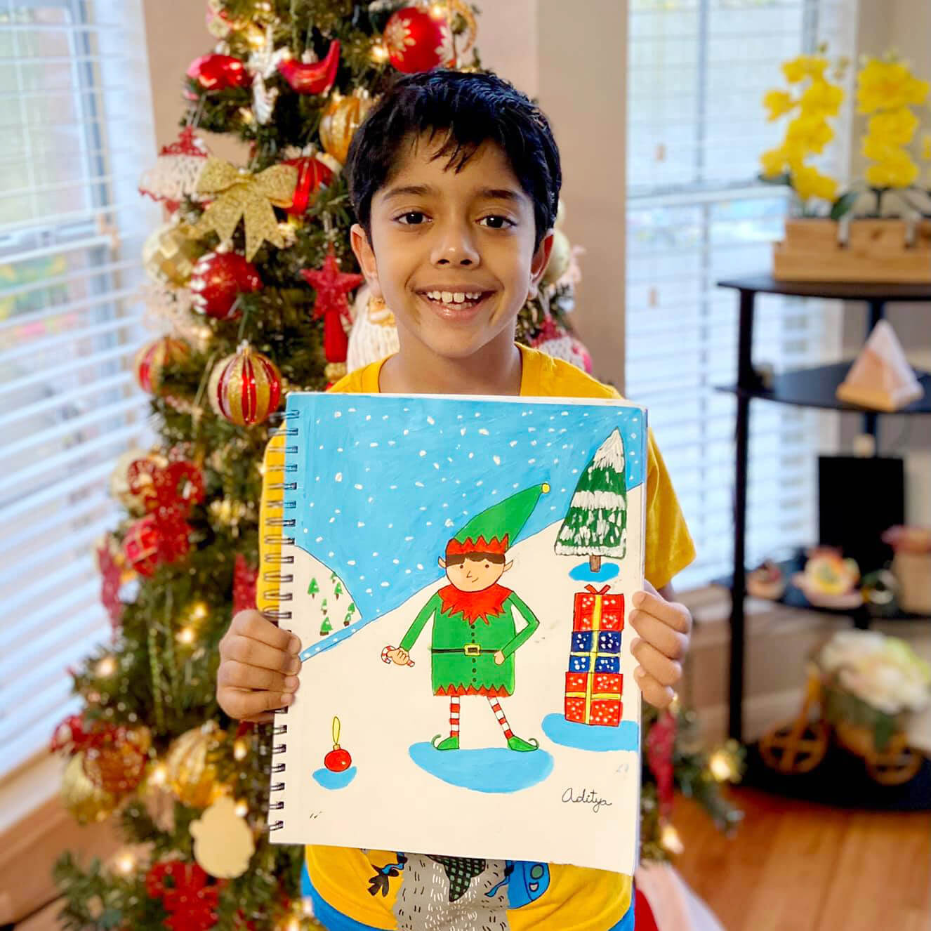 Cute elf christmas painting by a boy at Nimmy;s ARt online art classes for kids, Katy, Texas.