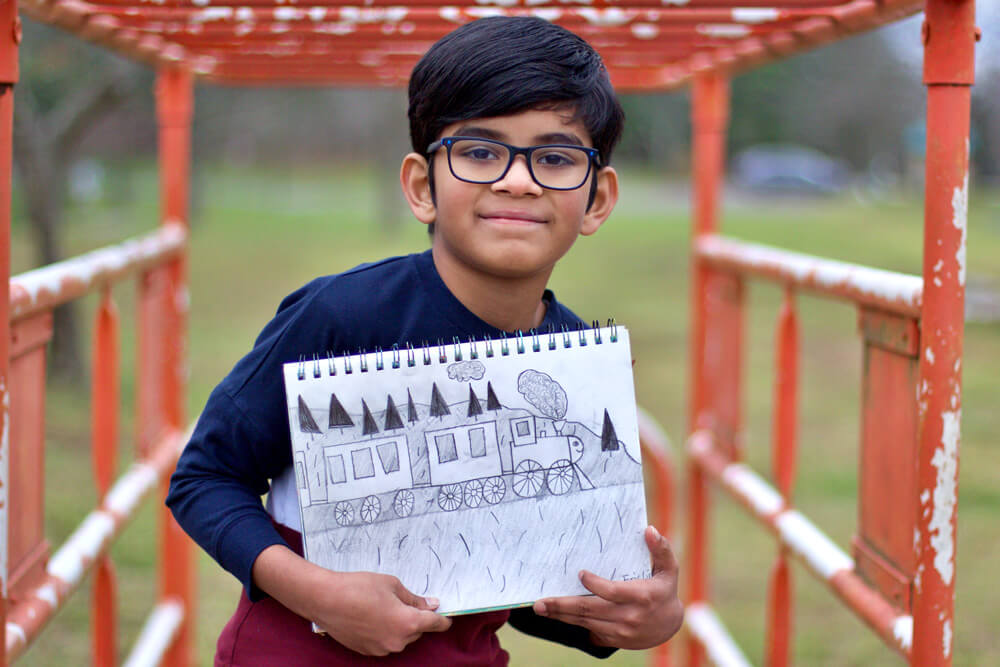 Eric posing with his pencil sketch project at Nimmy's Art, Katy, Texas.