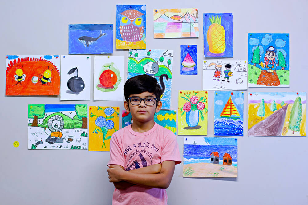 Eric Lijo with all his art work from online art classes at Nimmy's Art, Katy, Texas.