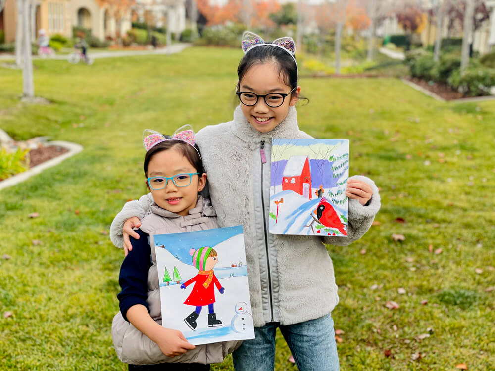 Abigail and her sister Zoe with their winter artwork at Nimmy's Art online classes located in Katy, Texas