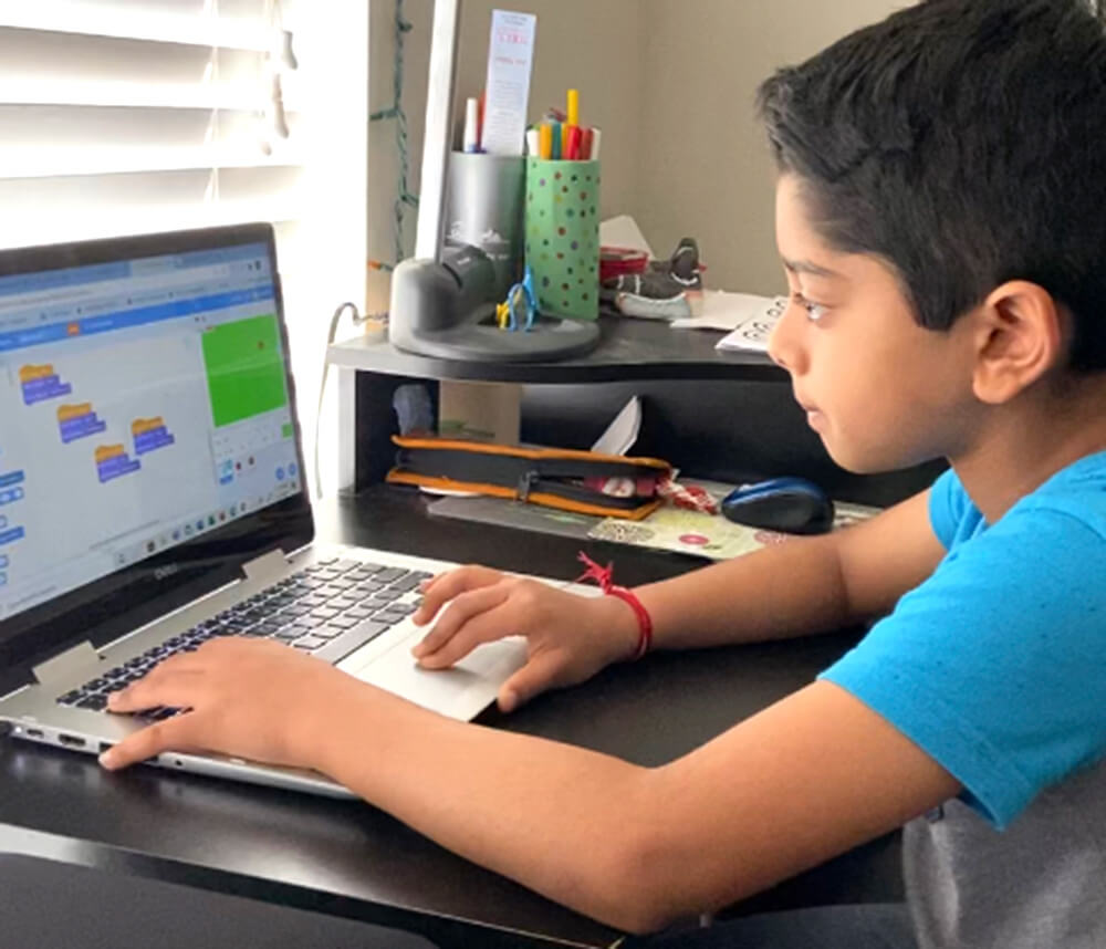 Coding passion - Aditya creating programs in Python and Scratch