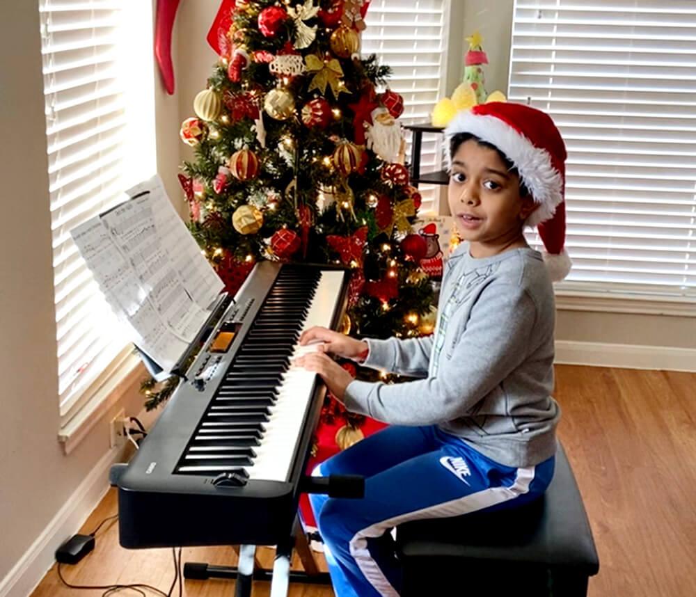 Aditya playing the Christmas song on piano