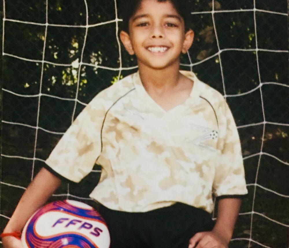 Aditya holding the soccer ball