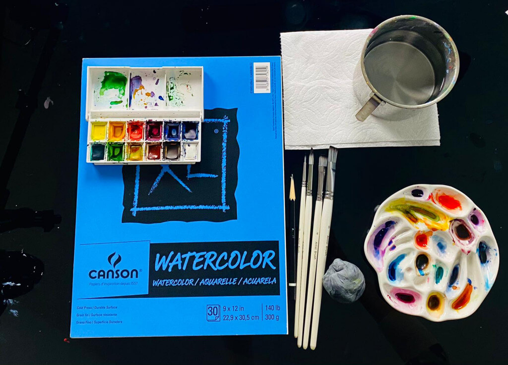 Materials required for watercolor in Nimmy's Art online art classes - Canson watercolor book, Winsor & Newton Paint set and brushes