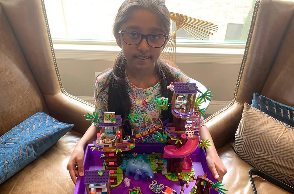 Prisha enjoys lego building