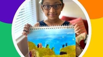Krupa in the artists spotlight holding her painting