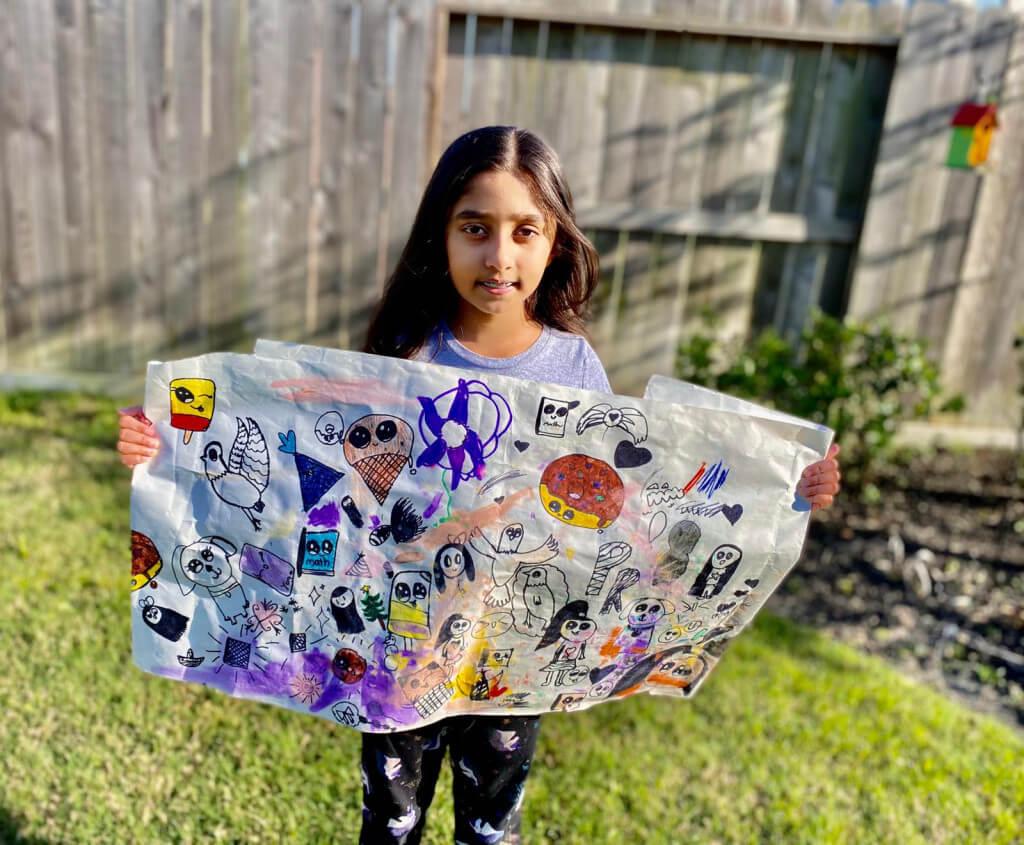 Prisha with her artwork